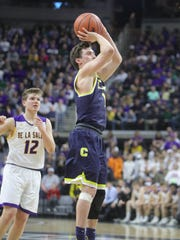 Clarkston guard Foster Loyer scores against Warren De La Salle during the third quarter of the Class A MHSAA semifinals Friday, March 23, 2018, at the Breslin Center in East Lansing.