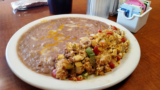 The machaca ($5.20) consists of dried beef, scrambled egg, tomato, bell pepper, jalapeno and onion, and comes with a serving of refried beans.
