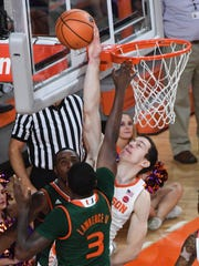 Clemson forward Mark Donnal(5) blocks the shot of Miami junior Mike Robinson(5) during the second half at Littlejohn Coliseum in Clemson on Saturday.