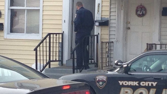Police convass the 200 block of South Penn Street after a person was shot in the area Sunday.