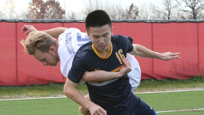 First-team all-state selection Nicholas Cheung (front) returns to lead perennial power Marquette this season.