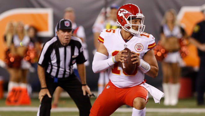 Kansas City Chiefs quarterback Patrick Mahomes (15) looks to throw a pass against the Cincinnati Bengals during the second half at Paul Brown Stadium.