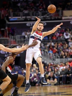 Washington Wizards guard Tomas Satoransky (31), of the Czech Republic, passes the ball against Portland Trail Blazers forward Noah Vonleh, left, during the second half of an NBA basketball game, Monday, Jan. 16, 2017, in Washington. The Wizards won 120-101. (AP Photo/Nick Wass)