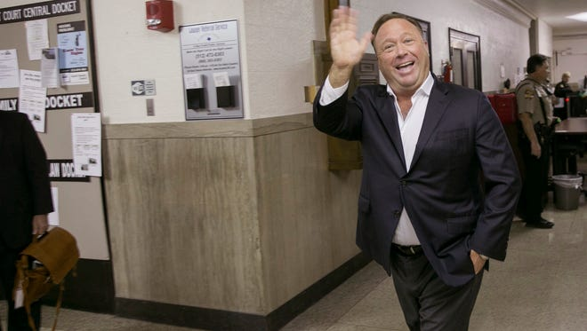 Alex Jones, a well-known broadcaster and provocateur, arrives for a child custody trial at the Heman Marion Sweatt Travis County Courthouse in Austin, Texas, on Wednesday. Kelly Jones is seeking sole or joint custody of the couples' children, ages 14, 12 and 9.