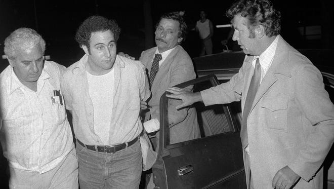 "Police escort handcuffed ""Son of Sam"" suspect David Berkowitz into headquarters in lower Manhattan on Aug. 10, 1977."
