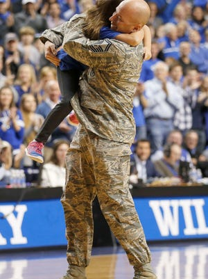 Nov 16, 2014; Lexington, KY, USA; Air Force Senior Master Sergeant James A. Allegrezza was reunited with his wife and two children at Rupp Arena during the game against the Kentucky Wildcats and the Buffalo Bulls . Kentucky defeated Buffalo 71-52. Mandatory Credit: Mark Zerof-USA TODAY Sports