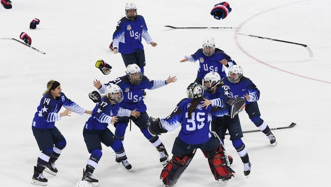 United States goaltender Madeline Rooney (35) celebrates with teammates after defeating Canada in the women's ice hockey gold medal match during the Pyeongchang 2018 Olympic Winter Games at Gangneung Hockey Centre.