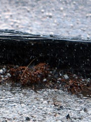Quarter-size hail pounded roofs and streets in Ruidoso twice on Wednesday.