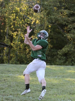 Bishop Brossart's Frank Cetrulo makes a reception during practice.