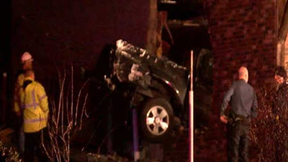 A pickup crashed into a utility pole and through a building early Monday.