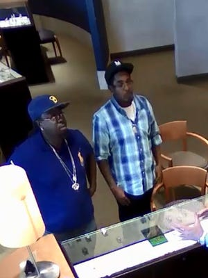Surveillance footage of the two main suspects in the Scottsdale jewelry store robbery.