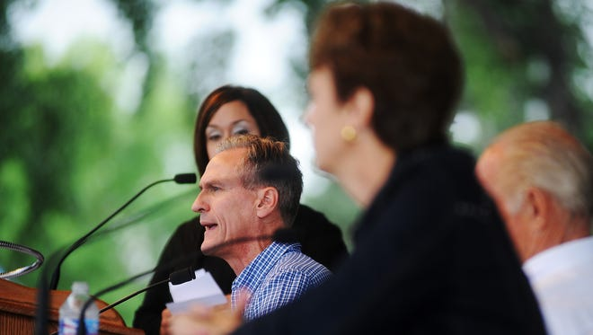 Republican Gov. Dennis Daugaard speaks during the gubernatorial debate between Gov. Daugaard, Democratic gubernatorial candidate, Susan Wismer and independent gubernatorial candidate, Mike Myers on the Freedom Stage on Friday, Aug. 29, 2014, at the South Dakota State Fair in Huron, S.D.