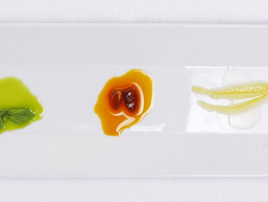 (L-R) citrus, chili and basil infused oil.