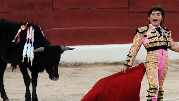 Franco-Mexican ten-year-old bullfighter Michelito performs during a bullfight at the bullring in Merida, Yucatan state, on January 24, 2009. Michelito killed six young bulls on January 24 in a controversial spectacle that child protection and anti-bullfighting campaigners had hoped to stop.    AFP PHOTO / Luis PEREZ (Photo credit should read Luis PEREZ/AFP/Getty Images)
