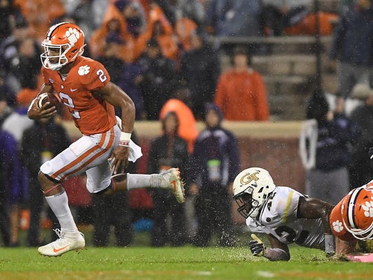 Clemson quarterback Kelly Bryant (2) carries past Georgia Tech defensive lineman KeShun Freeman (42) during the 2nd quarter on Saturday, Oct. 28, 2017 at Clemson's Memorial Stadium.