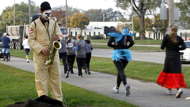 The Run of the Dead, a 5K and 10K event, is part of the Day of the Dead festivities in southwest Detroit.