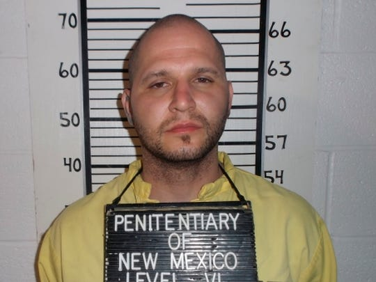 This photo provided by the New Mexico Corrections Department on Saturday shows inmate Joseph Cruz at the New Mexico State Penitentiary in Santa Fe. The escape of two inmates, Cruz and Lionel Clah, from a prison van has raised concerns about New Mexico's corrections system as questions linger over how the men could break free and flee hundreds of miles before anyone reported them missing.