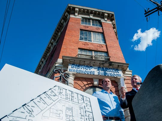 Montgomery Mayor Todd Strange, right, and hotel developer John Tampa, left, announce the development of a hotel in the old Bishop Parker building in Montgomery, Ala. on Wednesday September 21, 2016.