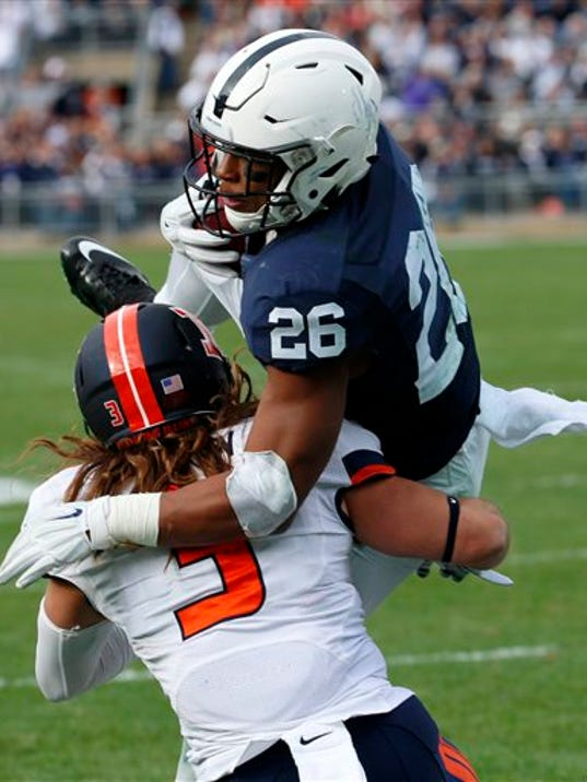 Penn State running back Saquon Barkley (26) dives over Illinois defensive back Taylor Barton (3) for a touchdown during the second half  in State College on Saturday. Penn State won 39-0.