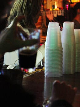 Stacks of go-cups at the Green Room in Downtown Lafayette in November 2010.