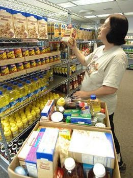 A woman shops at the St. Vincent de Paul Community Food Pantry in Merrill. A new bill would make it easier for the state to investigate fraud in the FoodShare program.