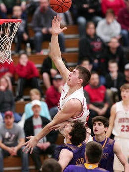 Johnstown senior Jason Carter soars to the basket in the Division II district semifinal win against Bloom-Carroll
