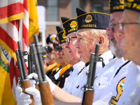 Members of the Waite Park Legion Color Guard listen to the speakers during the Memorial Day ceremony Monday at the St. Cloud VA Health Care System.