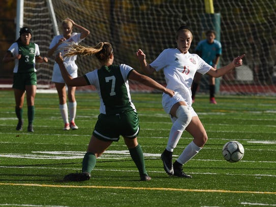 Red Hook's A.J. Fuchs-White, right, tries to stop the
