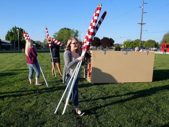 Volunteers set up flags on Friday for the Rotary Club