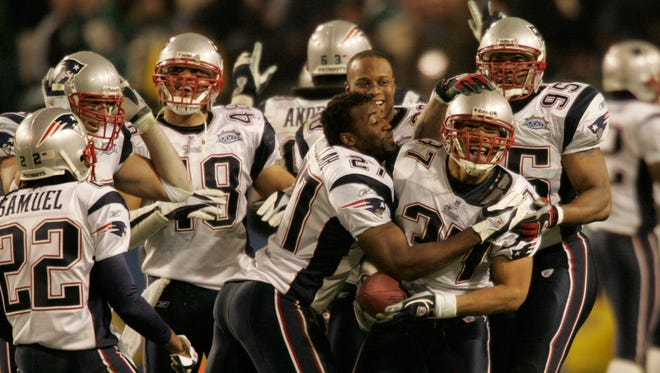 Rodney Harrison and Patriots celebrate the fourth quarter interception that ended Philly's hopes of winning.