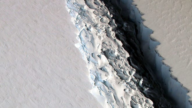 This photo released on Dec. 1, 2016, by NASA shows what scientists photographed in a view of a massive rift in the Antarctic Peninsula's Larsen C ice shelf on Nov. 10, 2016.