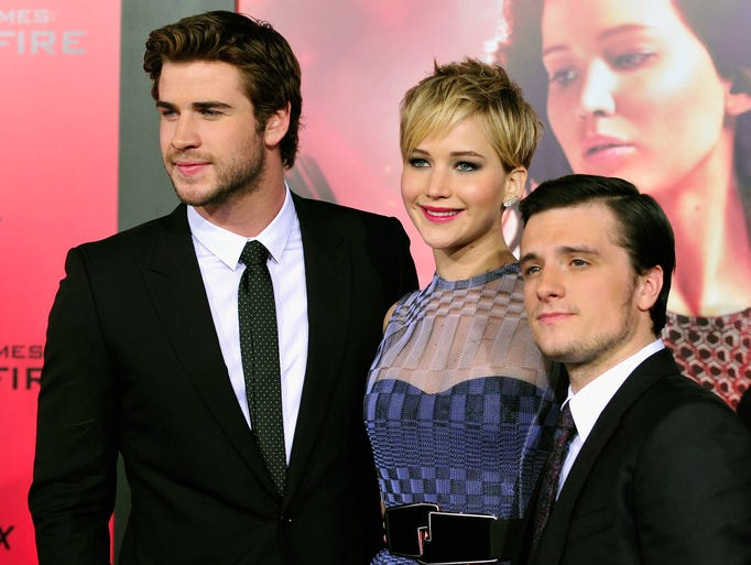 """Actors Liam Hemsworth (left), Jennifer Lawrence and Josh Hutcherson attend the premiere of Lionsgate's """"The Hunger Games: Catching Fire"""" at the Nokia Theatre on Tuesday, Nov. 18, 2013 in Los Angeles"""