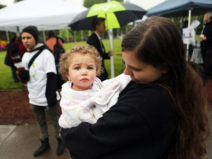 Amanda Willard of Youth M.O.V.E. Oregon with 13-month-old Renee Carter. Families, youth and mental health advocates meet at the State Capitol to raise awareness around the needs of children and young adults who experience mental health challenges.