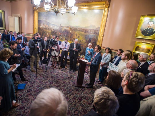 Senate President Pro Tempore Tim Ashe, D/P-Chittenden, right, joined by Speaker of the House Mitzi Johnson, D-South Hero, speaks at a press conference before the start of a special session of the Legislature at the Statehouse in Montpelier on Wednesday, May 23, 2018.  The press conference was held to criticize Gov. Phil Scott for vetoing a minimum wage bill and a paid family leave bill.