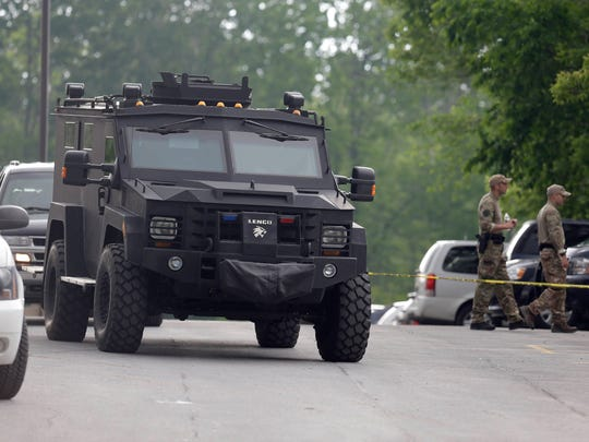 A heavily armored vehicle drives through a staging area during a search for two escaped prisoners near Dannemora, N.Y., Thursday, June 11, 2015. Police have blocked off the main road outside a northern New York village as authorities concentrate their sixth day of searching for David Sweat and Richard Matt on a swampy area just a couple miles from the prison the convicts broke out of last weekend.