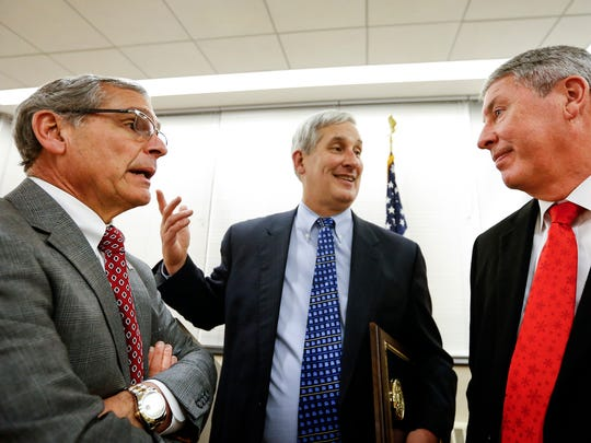 From left, Chemung County executive Tom Santulli, Corning Enterprises President G. Thomas Tranter, and Schuyler County administrator Timothy O'Hearn talk after announcing a $500 million Upstate Revitalization Initiative grant in 2015.