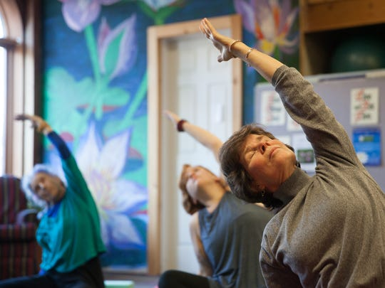 Meg Tipper of Burlington attends a yoga class Monday morning in Burlington at the Turning Point Center.