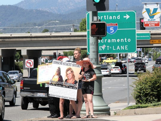 Nicole Santos-Hamann holds a poster in June with information