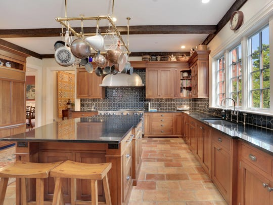 The Normandy Tudor at 49 Algonquin Drive boasts a chefs kitchen and a butlers pantry.