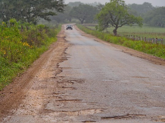A badly damaged section of road near Cheapside, between Gonzales and Cuero, on April 10, 2018.