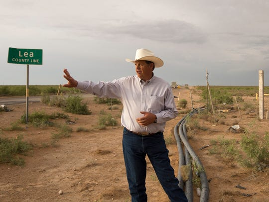 New Mexico State Land Commissioner Aubrey Dunn stands