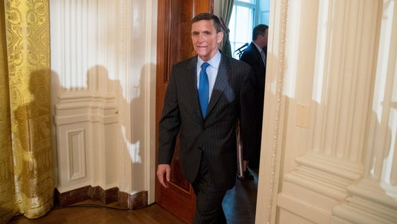 Michael Flynn arrives for a White House senior staff