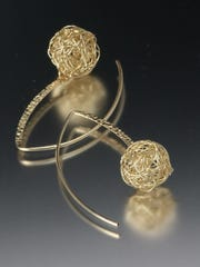 Earrings by Angela Lensch, who is taking part in the