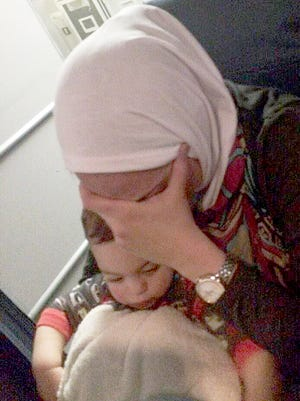 Darlene Hider, of Dearborn, on Delta flight from Florida to Detroit, says she was harassed Monday by a passenger because of her Islamic headscarf.