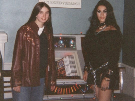 LaRonika Thomas, left, and Maya Carless pose next to