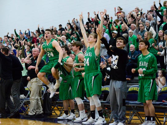 Brycetyn Hedden jumps into the air celebrating a 3-pointer from Dylan Morris during Margaretta's win Thursday over Huron.