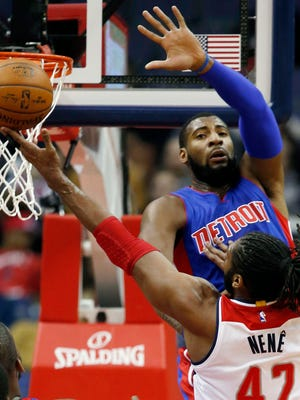 Detroit Pistons center Andre Drummond, top, plays against the Washington Wizards on Feb. 28, 2015, in Washington.