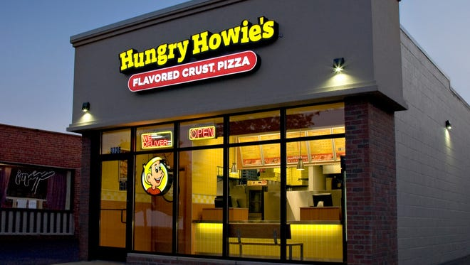 Brothers Steve, Jim, and Mike Peterson have opened 17 Hungry Howie's stores, including this Dearborn location. They're opening their 18th location in Milford this week.