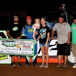 Jason Hughes (second from left) celebrates with his crew and family after winning Thursday's MARS race at Monett Speedway.