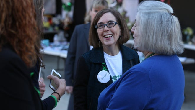 Oregon Gov. Kate Brown addresses students with Rita Cavin, interim Umpqua Community College President, right, and Vanessa Becker, chair of UCC Board, at Umpqua Community College, Monday, Oct. 12, 2015, in Roseburg, Ore. Monday was the first day back to campus for students since the deadliest shooting in state history on Oct. 1. (Beth Nakamura/The Oregonian via AP, Pool)